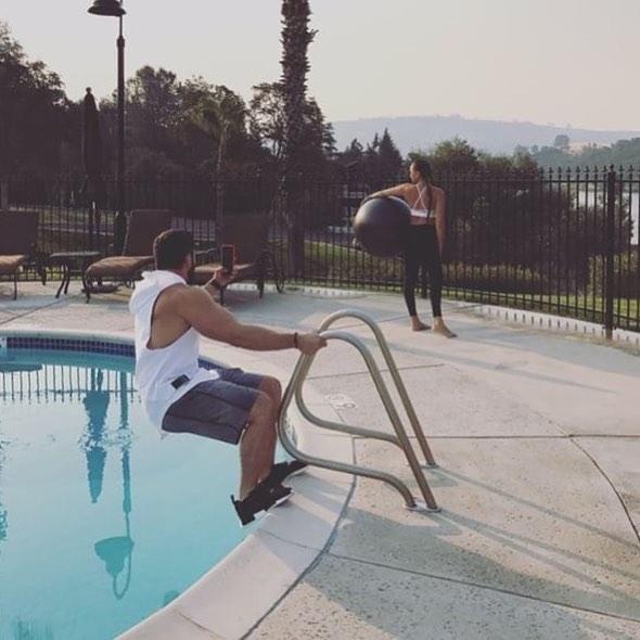 men taking beside swimming pool