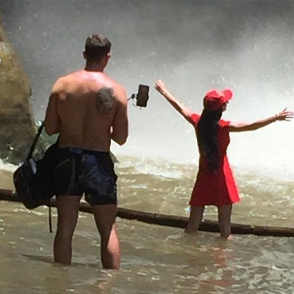 taking photo standing in the water