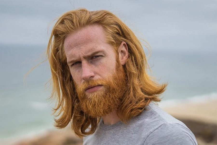 ginger layered medium haircut with full beard