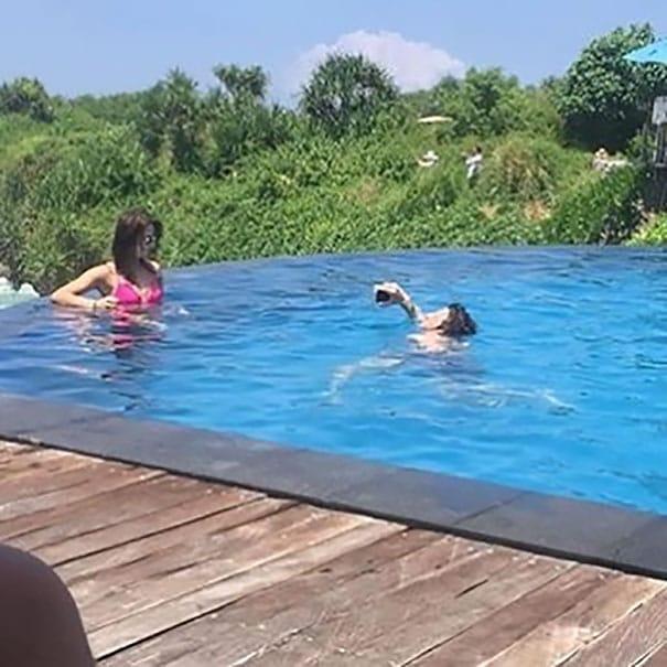 women capture her image standing in pool