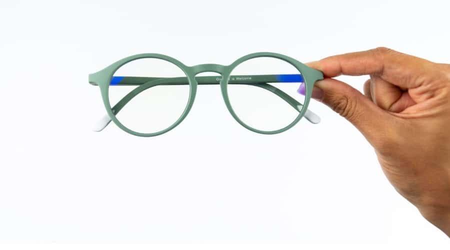 blue light blocking glasses in hand