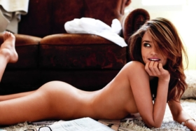 Miranda posing lying on her stomach on floor in the nudes