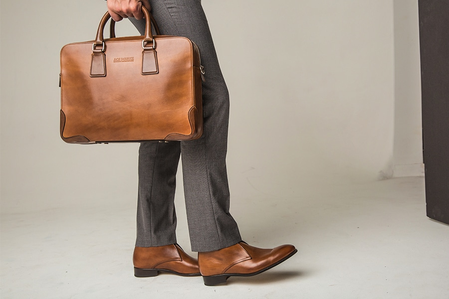 ace marks dress shoes leather bag in hand