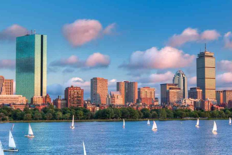 boston skyline over the charles river and sailboats