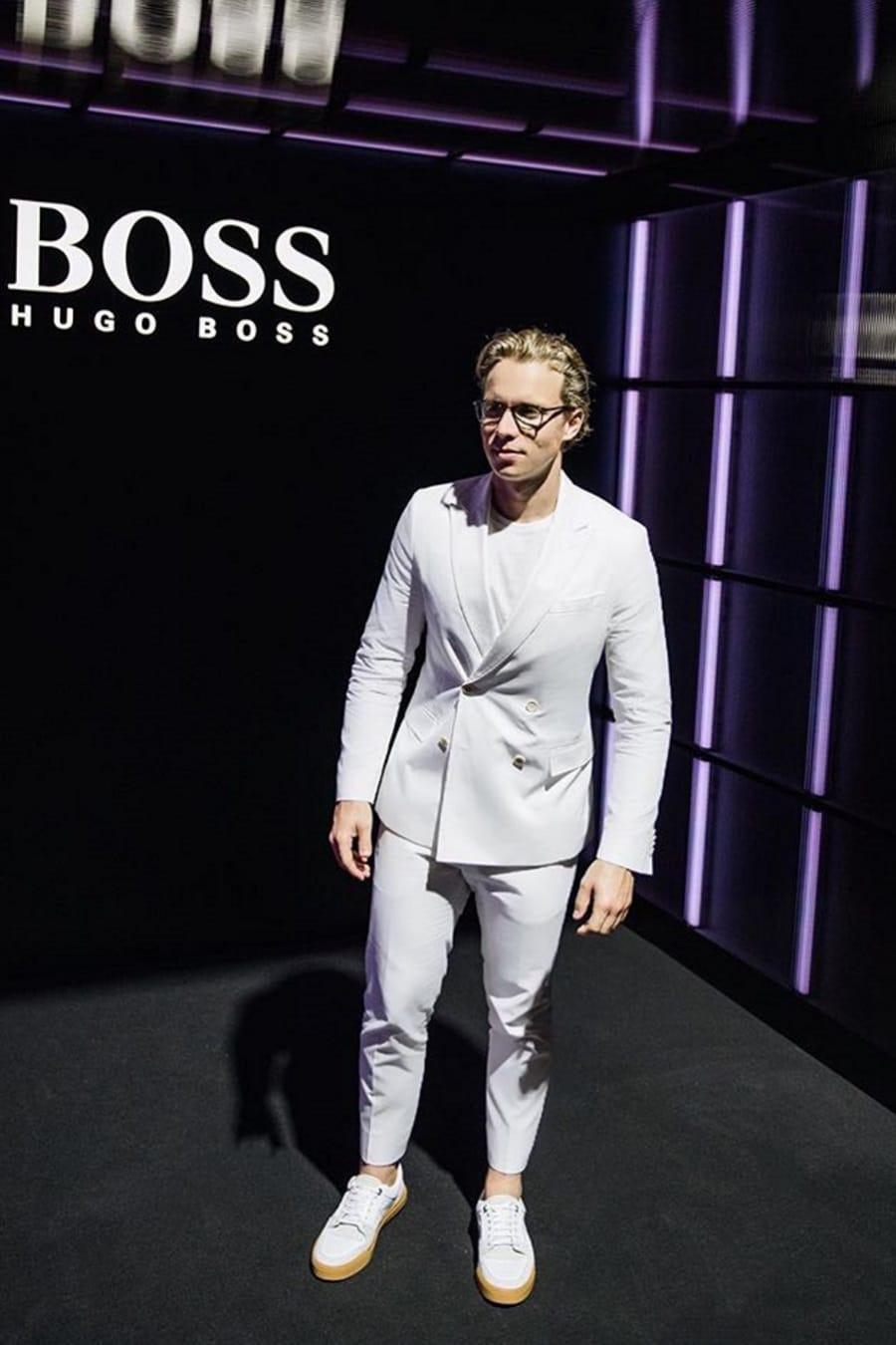 dalton graham wearing white suit