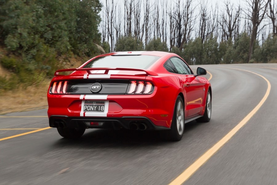 ford mustang gt running on the road