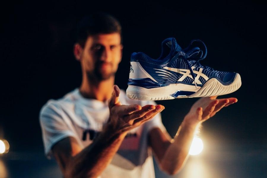 novak djokovic with asics tennis shoes