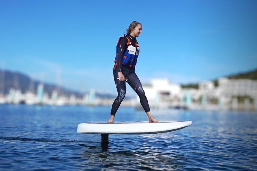 woman standing on waydoo hydrofoil board