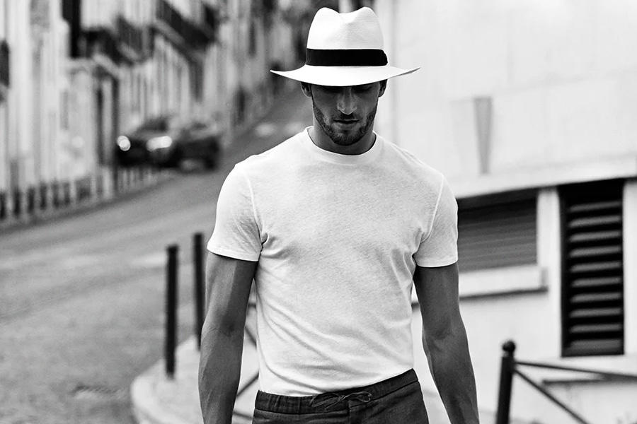 Man in white tshirt and fedora