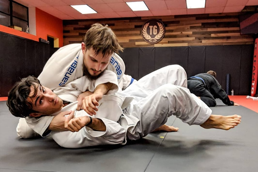 People practicing BJJ at Training Grounds gym
