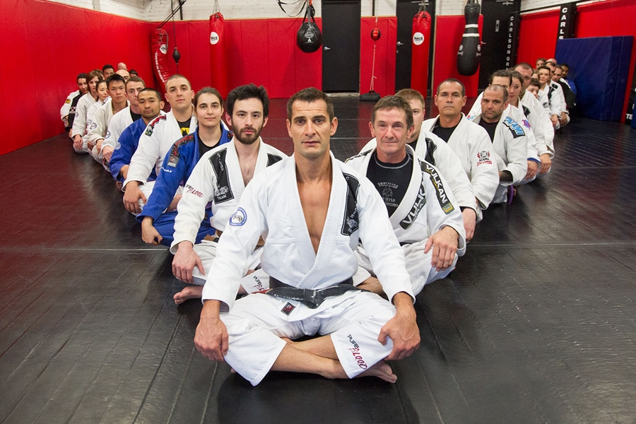 Carlson Gracie trainers in V formation on floor