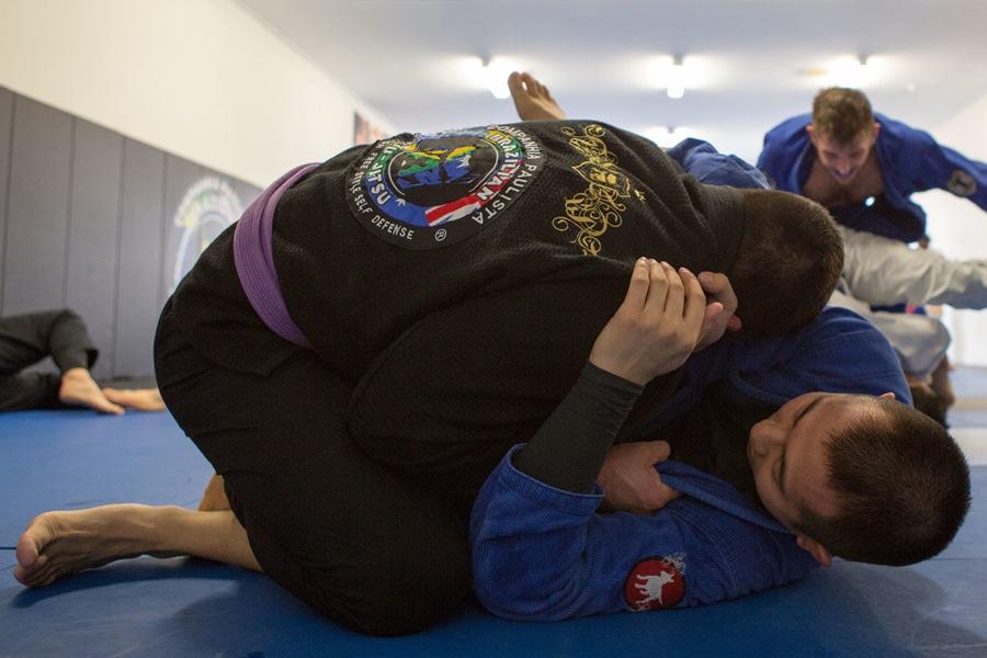 Two men fighting Jiu Jitsu