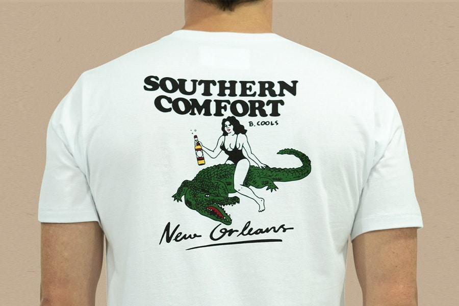 Back of a man wearing Southern Comfort graphic printed t-shirt