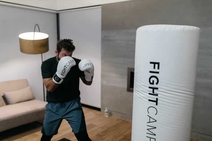 Man boxing with fight camp boxing bag