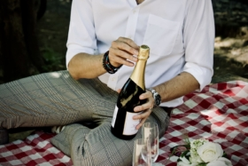 A man holding a champagne bottle