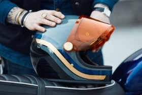 Motorcycle helmet in a man's hand