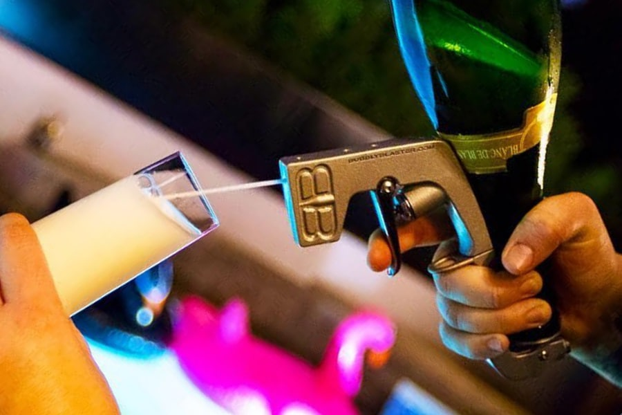 A hand usingBubbly Blaster Champagne Gun