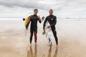 Gasly and Mick with surfboards at beach