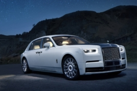 Rolls Royce Phantom three quarter front at night
