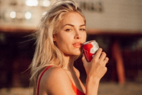 Model holding a can near her mouth