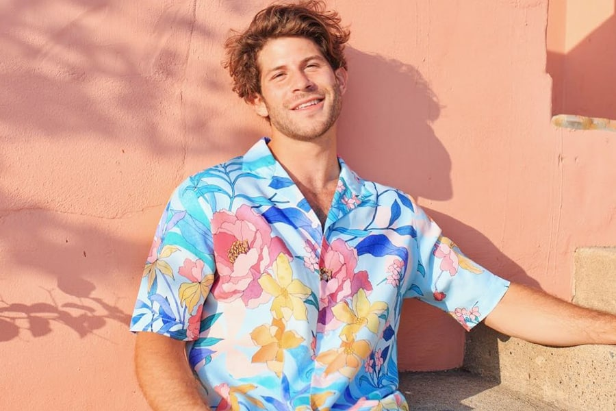 Model in a blue and pink Hawaiian shirt