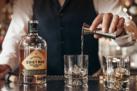 Man pouring The Quiet Man Whiskey