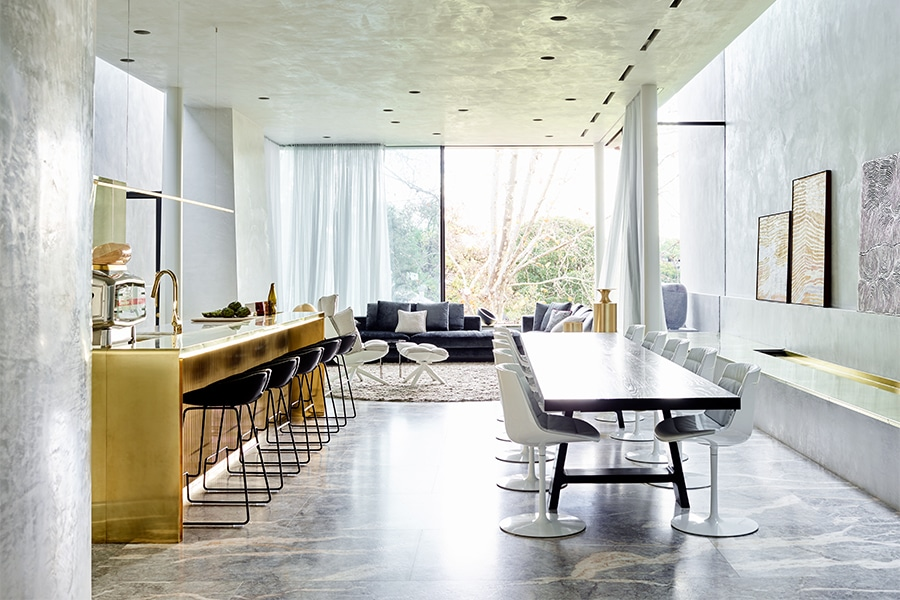 Dining table and bar with lounge in background