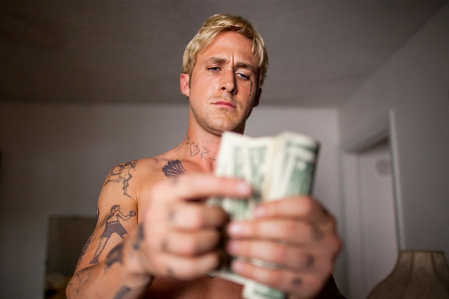 Ryan Gosling with Bleached Hair counting money