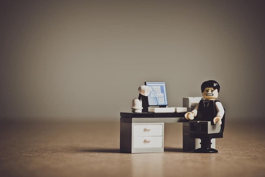 Sad lego man at desk