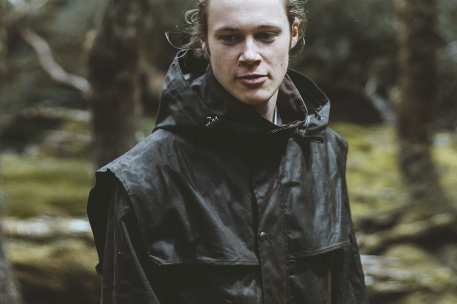man in black finders keeper outerwear in forest