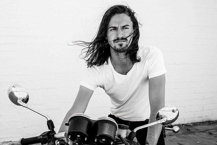 man with motorbike and long hairstyle
