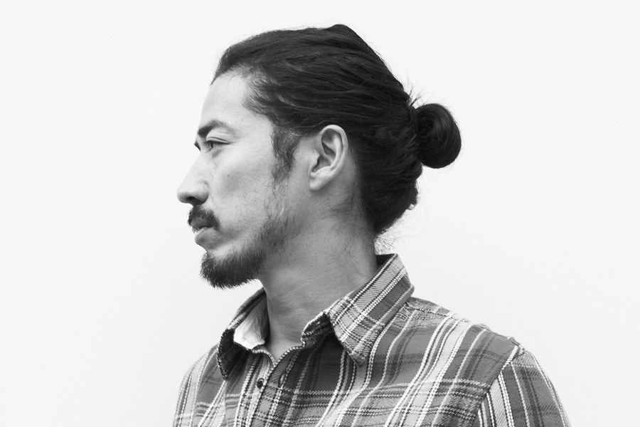 asian man with long haircut man bun hairstyle