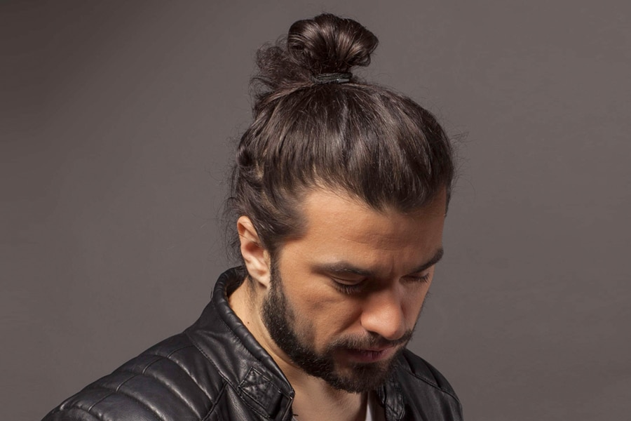man with manbun long hairstyle haircut
