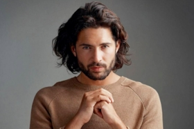 Man with long curly haircut brown hairstyle