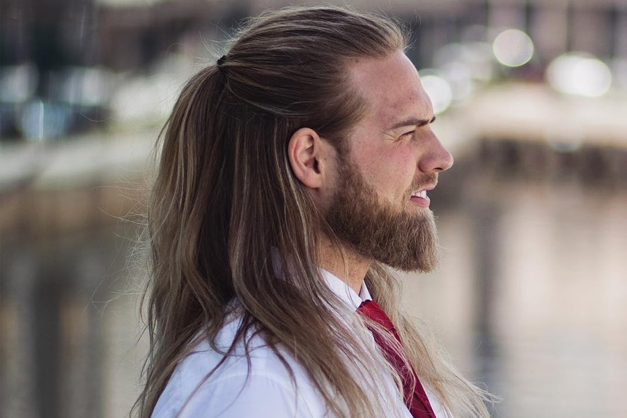 Man with long haircut half up half down hairstyle