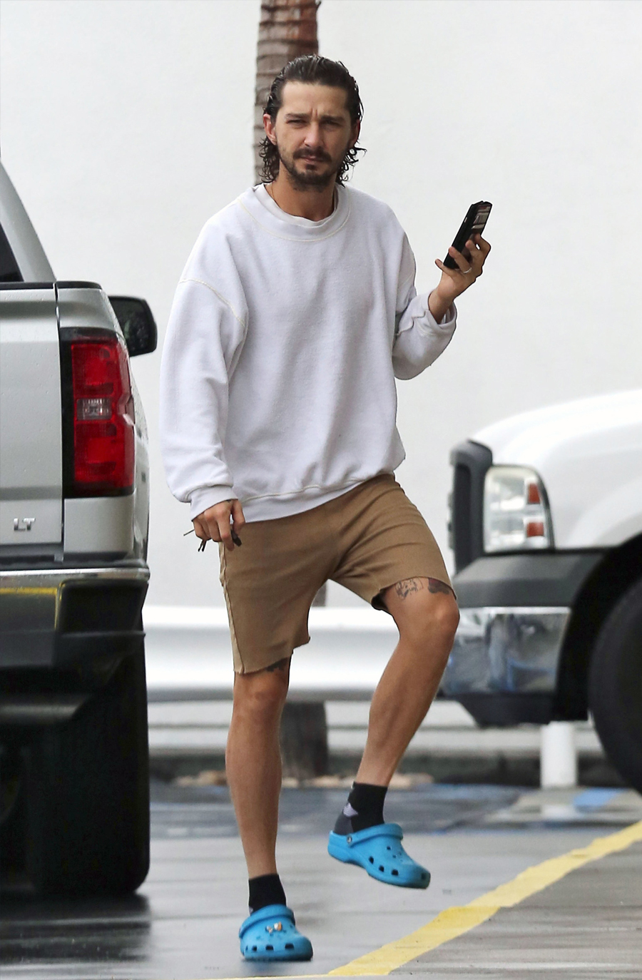 Shia Lebeouf in blue crocs