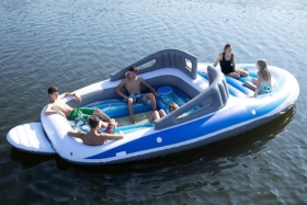 sun bathing in inflatable speed boat at sea