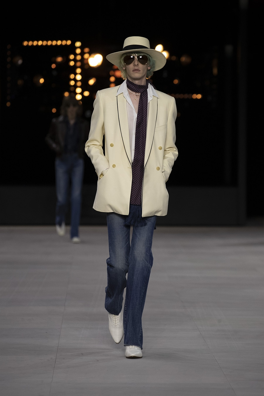 Model on Celine runway with velvet white blazer