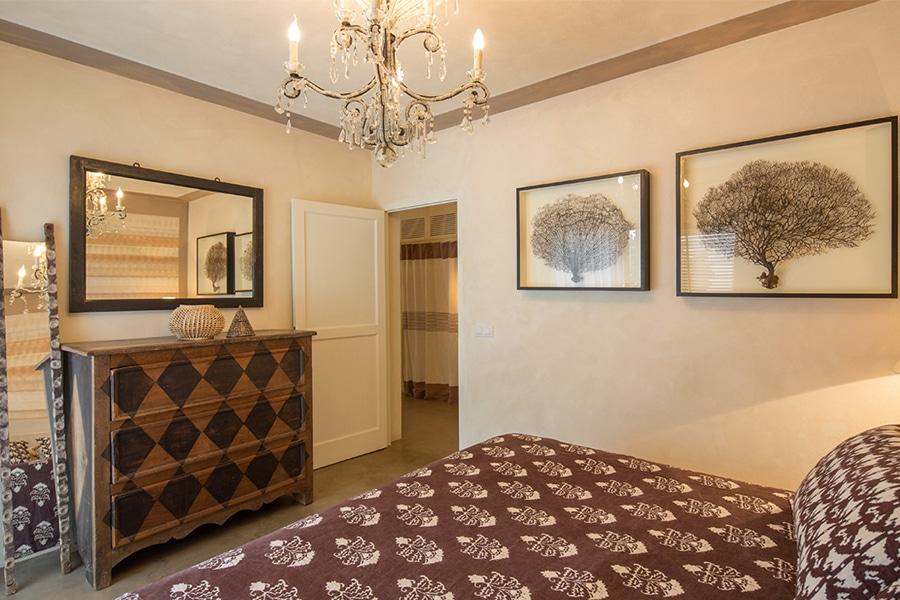 casa lp formentera paintings in bedroom