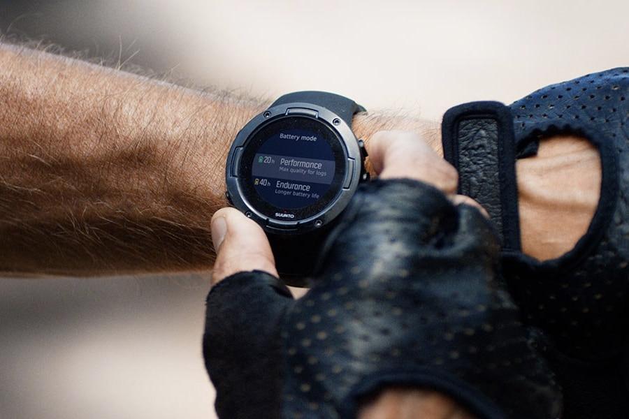 Man wearing Suunto black watch