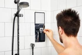 Man putting brush in Tooletries tile pocket