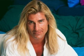man with long blonde hair