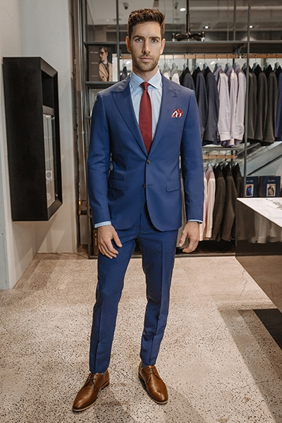 good looking guy in blue suit and red tie