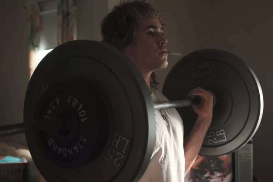 Dacre Montgomery lifting weights