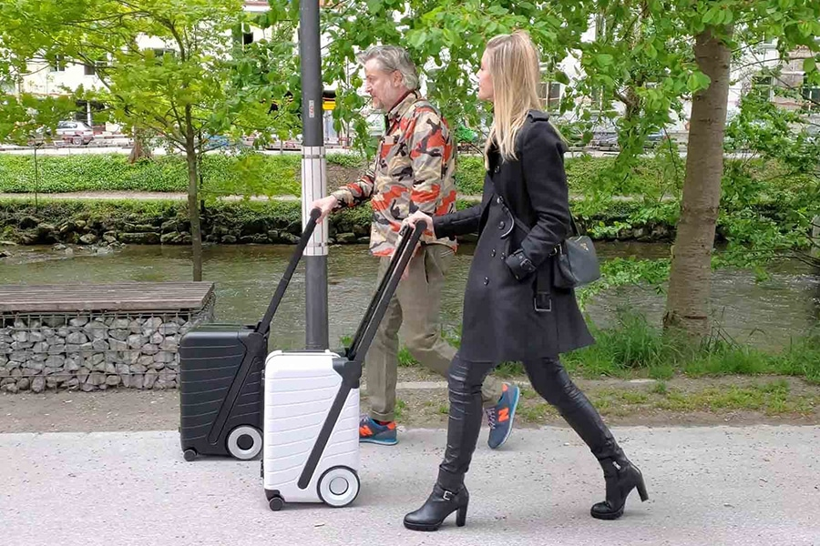 both man and woman use G Ro The Six Luggage