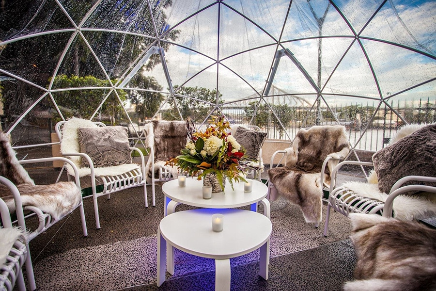 beautiful chairs and flowers inside the garden dome igloo