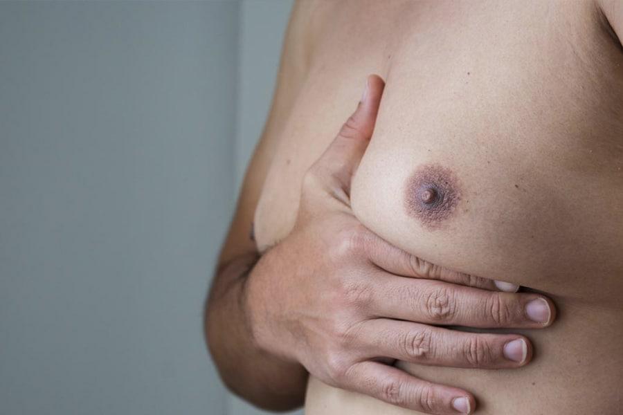 Man holding Man boob