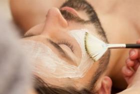 Man having facial treatment