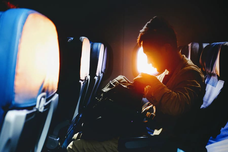 Silhouette of man on plane