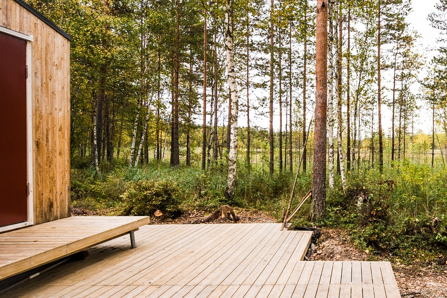 wood cabin terrace with trees view in sorrounding